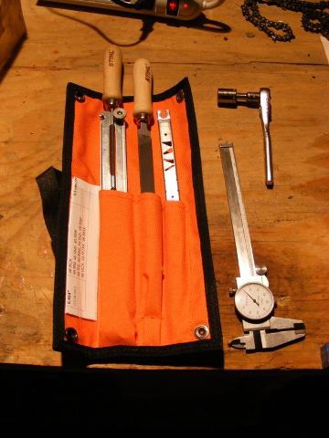 Tools needed to sharpen a chainsaw.