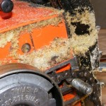 sawdust that indicates a chain needs to be sharpened