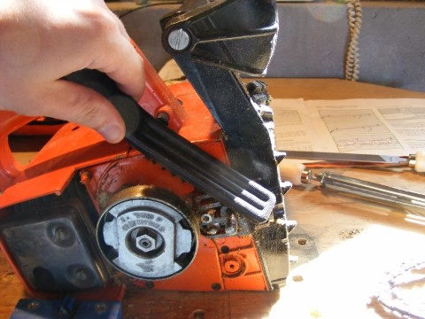 cleaning the saw with a stiff nylon brush