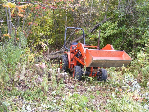 Kubota B1750 set up to skid logs.