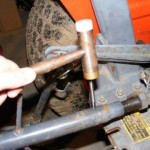 Hammering the bolt extractor into the broken port.